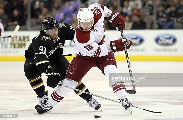 Petr Prucha of the Phoenix Coyotes skates the puck against Brad Richards of the Dallas Stas in the second period at American Airlines Center on...