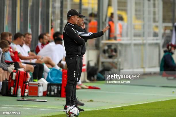 Petr Ruman , coach of Türkgücü Munich, and Urs Fischer, coach of Union Berlin, during the DFB Cup first round match between Türkgücü Munich and 1. FC...