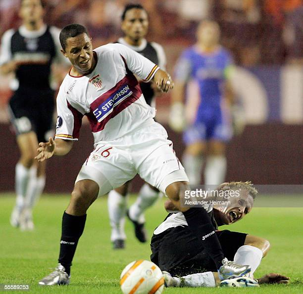 Petr Ruman of Mainz competes with Adriano of Sevilla during the UEFA Cup match between FC Sevilla and FSV Mainz 05 at the stadion Ramon Sanchez...