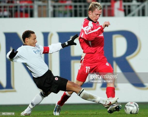 Petr Ruman of Mainz fights for the ball with Jermaine Jones of Frankfurt during the Bundesliga match between FSV Mainz 05 and Eintracht Frankfurt at...