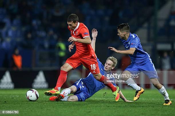 Petr Sevcik of Liberec competes for the ball with Sebastian Cristoforo of Fiorentina during the UEFA Europa League match between FC Slovan Liberec...