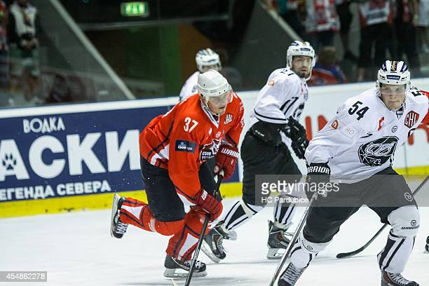 Petr Sykora of HC Pardubice chasing Mikko Lehtonen of TPS Turku during the Champions Hockey League group stage game between HC Pardubice and TPS...