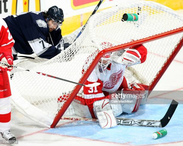 Petr Sykora of the Edmonton Oilers tips the net on top of Joey MacDonald of the Detroit Red Wings at the Rexall Place on November 18 2006 in Edmonton...