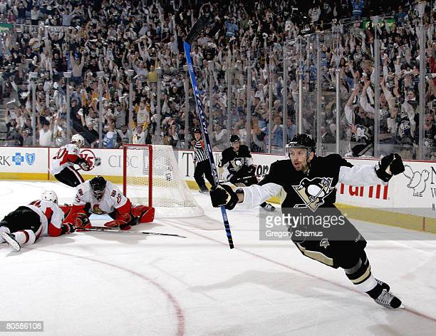 Petr Sykora of the Pittsburgh Penguins celebrates his goal in front of Martin Gerber of the Ottawa Senators during game one of the 2008 NHL...