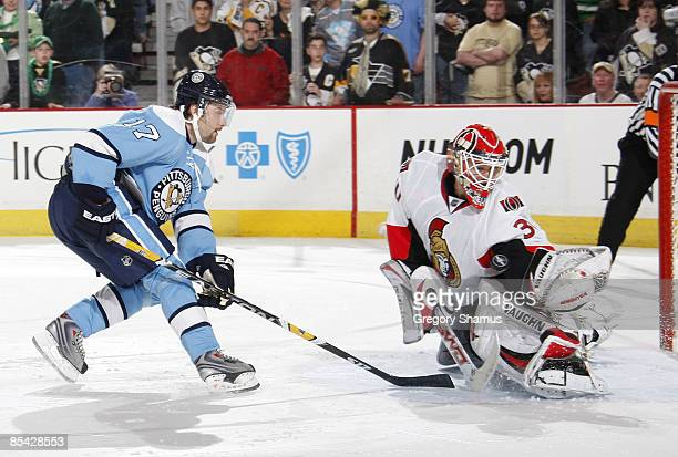 Petr Sykora of the Pittsburgh Penguins has his shootout attempt stopped by Brian Elliott of the Ottawa Senators on March 14 2009 at Mellon Arena in...