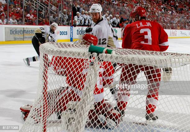 Petr Sykora of the Pittsburgh Penguins scores the game winning goal past goaltender Chris Osgood of the Detroit Red Wings during game five of the...