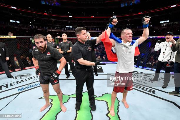Petr Yan of Russia celebrates his victory over Jimmie Rivera in their bantamweight bout during the UFC 238 event at the United Center on June 8, 2019...