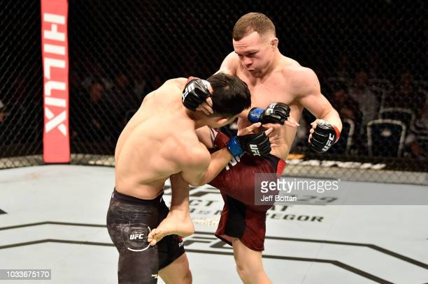 Petr Yan of Russia knees Jin Soon Son of South Korea in their bantamweight bout during the UFC Fight Night event at Olimpiysky Arena on September 15...