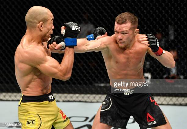 Petr Yan of Russia punches Jose Aldo of Brazil in their UFC bantamweight championship fight during the UFC 251 event at Flash Forum on UFC Fight...