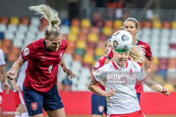 Petra Bertholdova of Czech Republic and Paulina Dudek of Poland are seen in action during the UEFA Women's EURO 2021 qualifying match between Poland...
