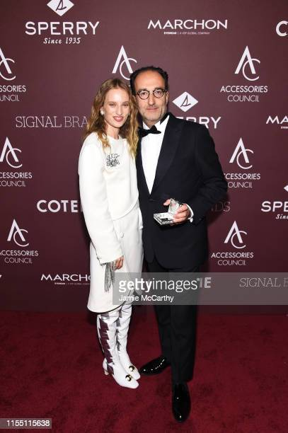 Petra Collins and Roberto Vedovotto pose with the Business Visionary award backstage at the Accessories Council Hosts The 23rd Annual ACE Awards on...