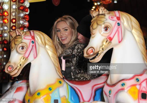Petra Ecclestone and James Stunt attends the Hyde Park Winter Wonderland VIP opening on November 21 2013 in London England