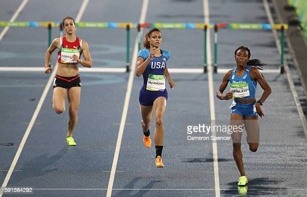 Petra Fontanive of Switzerland Sydney McLaughlin of the United States and Ayomide Folorunso of Italy compete in the Women's 400m Hurdles Round 1 on...