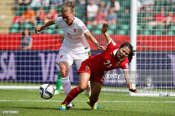 Petra Hogewoning of Netherlands defends Wang Lisi of China PR during the FIFA Women's World Cup Canada 2015 Group A Match at Commonwealth Stadium on...