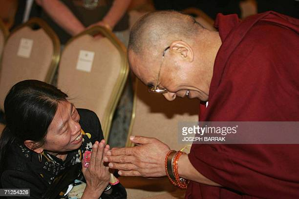 A woman greets 21 June 2006 the Dalai Lama at the Second Petra Conference of Nobel Laureates 21 June 2006 in the ancient city of Petra about 80...