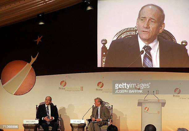 Israeli Prime Minister Ehud Olmert talks 22 June 2006 during a session with Elie Wiesel at the Second Petra Conference of Nobel Laureates in the...