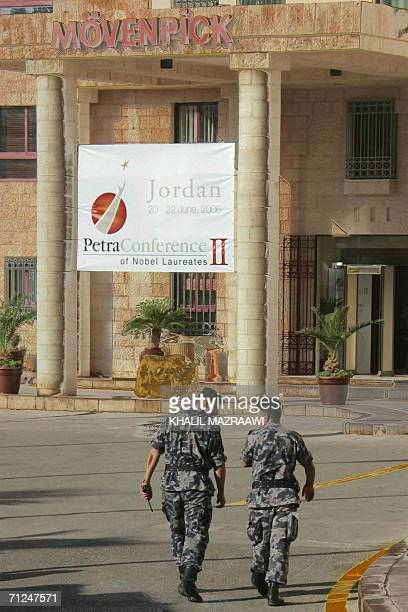 Jordanian security men walk into the hotel where Nobel laureates and worldrenowned leaders will open the twoday Second Petra Conference of Nobel...