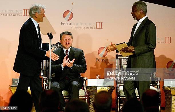King Abdullah II of Jordan claps as former UN secretary general Kofi Annan who won the Nobel Prize in 2001 attempts to shake hands Elie Wiesel a...