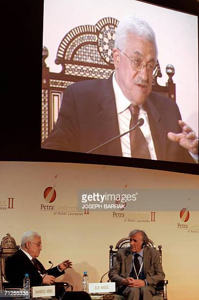Palestinian President Mahmud Abbas speaks during a session with Elie Wiesel held at the Second Petra Conference of Nobel Laureates in the ancient...