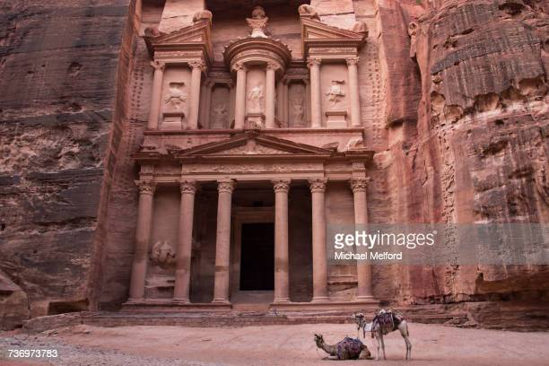 The Treasury carved out of a sandstone rock face.