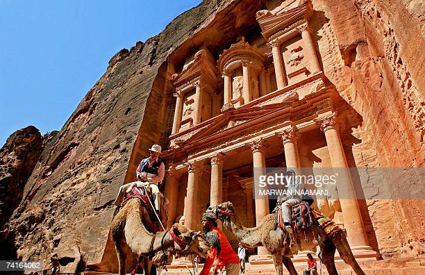 Tourists ride camels at the ancient ruins of Petra in Jordan 16 May 2007 Petra is hosting a twoday conference dubbed as Petra III Building a Better...