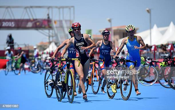 Petra Kurikova of Czech Republic and Inna Ryzhykh of Ukraine dismount in the Women's Triathlon Final during day one of the Baku 2015 European Games...