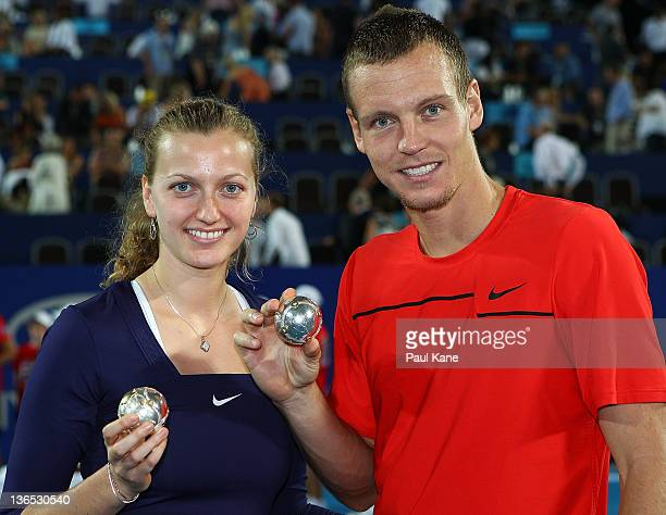Petra Kvitova and Tomas Berdych of the Czech Republic hold the diamond encrusted tennis balls after defeating Marion Bartoli and Richard Gasquet of...