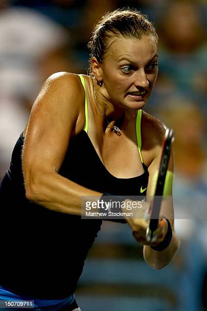 Petra Kvitova of Cezch Republic rewturns a shot to Sara Errani of Italy during the semifinals of the New Haven Open at Yale at the Connecticut Tennis...