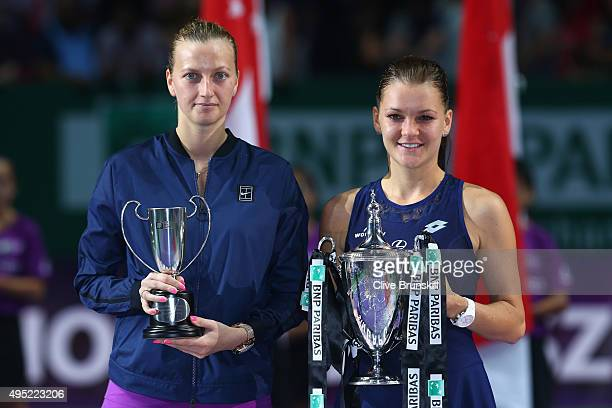 Petra Kvitova of Czech Republic and Agnieszka Radwanska of Poland pose with their trophies after their finals match during the BNP Paribas WTA Finals...