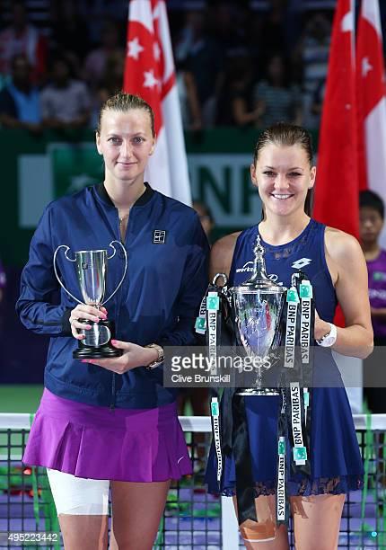 Petra Kvitova of Czech Republic and Agnieszka Radwanska of Poland pose with their trophies after their finals match during the BNP Paribas WTA Finals...