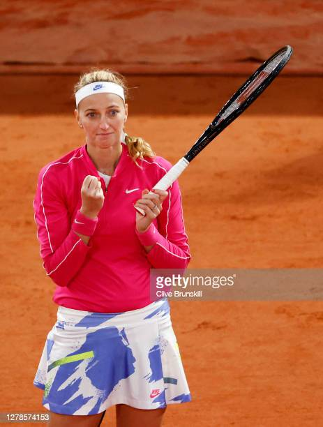 Petra Kvitova of Czech Republic celebrates after winning match point during her Women's Singles fourth round match against Shuai Zhang of China on...