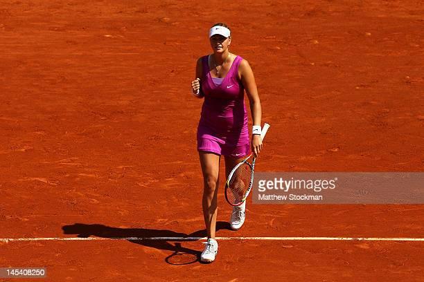 Petra Kvitova of Czech Republic celebrates match point in her women's singles first round match between Ashleigh Barty of Australia and Petra Kvitova...