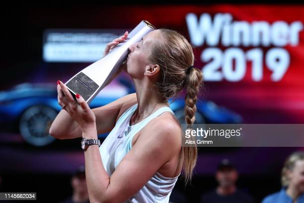 Petra Kvitova of Czech Republic celebrates with the trophy after winning the final match against Anett Kontaveit of Estonia on day 7 of the Porsche...