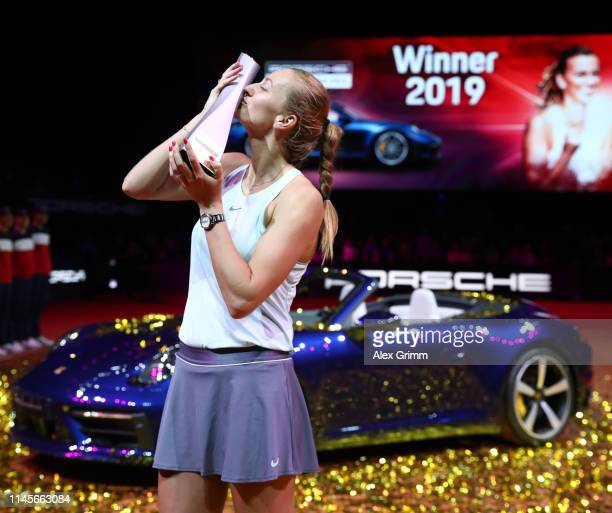 Petra Kvitova of Czech Republic celebrates with the trophy in front of the Porsche Carrera 4S after winning the final match against Anett Kontaveit...