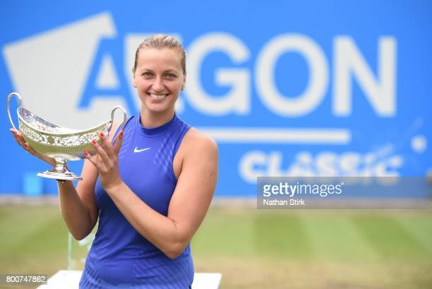 Petra Kvitova of Czech Republic holds the Maud Watson trophy after beating Ashleigh Barty of Australia on day seven of The Aegon Classic Birmingham...