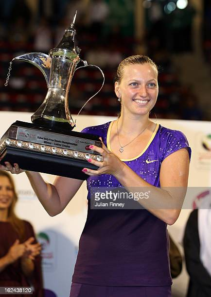 Petra Kvitova of Czech Republic holds the trophy after defeating Sara Errani of Italy in the final during day six of the WTA Dubai Duty Free Tennis...
