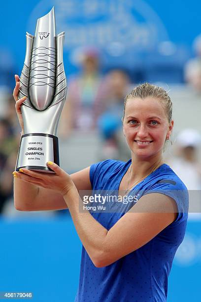 Petra Kvitova of Czech Republic holds the trophy to celebrate at the award ceremony after winning the final match against Eugenie Bouchard of Canada...