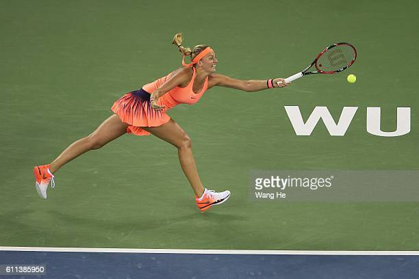 Petra Kvitova of Czech Republic Jelena Jankovic of Serbia returns a shot to Johanna Konta of Great Britain during their fifth round on Day 5 of the...