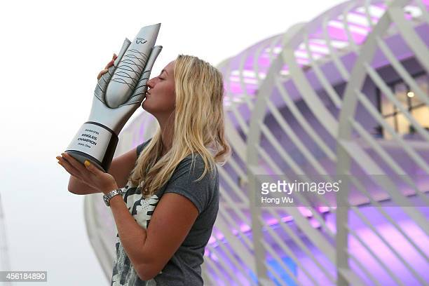 Petra Kvitova of Czech Republic kisses the trophy to celebrate after winning the final match against Eugenie Bouchard of Canada on day seven of 2014...