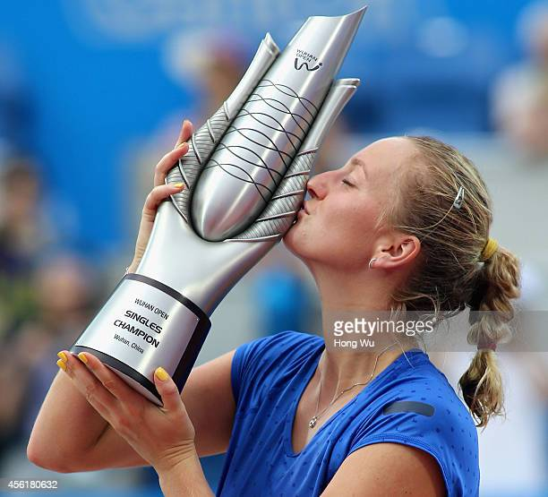 Petra Kvitova of Czech Republic kisses the trophy to celebrate at the award ceremony after won the final match against Eugenie Bouchard of Canada on...