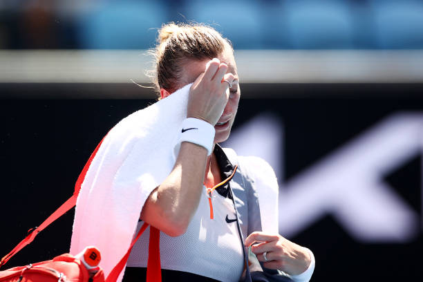 Petra Kvitova of Czech Republic looks on after losing her Women's Singles second round match against Sorana Cirstea of Romania during day three of...