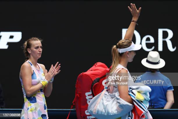 Petra Kvitova of Czech Republic looks on as Paula Badosa of Spain acknowledges the crowd following their Women's Singles second round match on day...