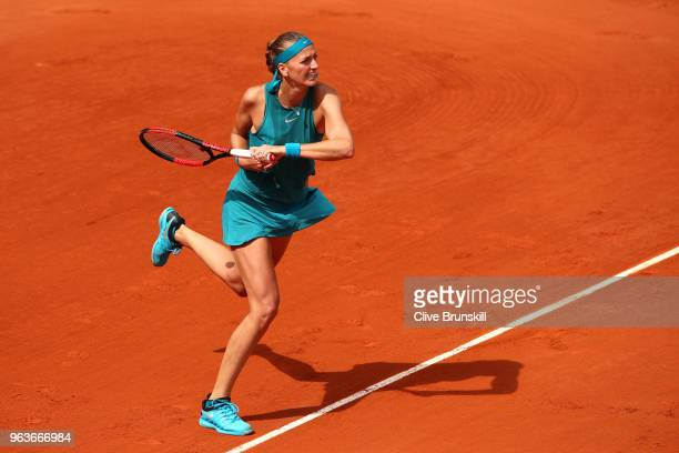 Petra Kvitova of Czech Republic plays a backhand during her laies singles second round match against Lara Arruabarrena of Spain during day four of...