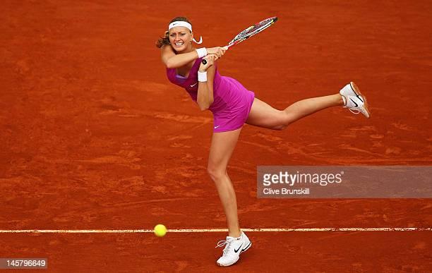 Petra Kvitova of Czech Republic plays a backhand in her women's singles quarter final match against Yaroslava Shvedova of Kazakhstan during day 11 of...