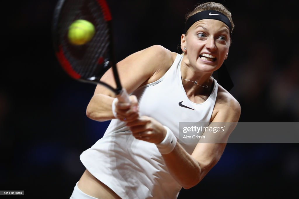 Petra Kvitova of Czech Republic plays a backhand to Angelique Kerber of Germany during day 3 of the Porsche Tennis Grand Prix at Porsche-Arena on April 25, 2018 in Stuttgart, Germany.