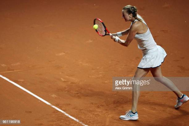 Petra Kvitova of Czech Republic plays a backhand to Angelique Kerber of Germany during day 3 of the Porsche Tennis Grand Prix at PorscheArena on...