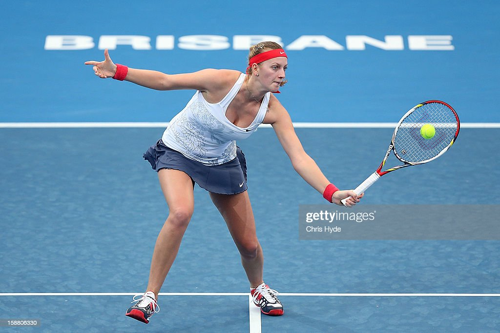 Petra Kvitova of Czech Republic plays a forehand in her match against Carla Suarez Navarro of Spain during day one of the Brisbane International at Pat Rafter Arena on December 30, 2012 in Brisbane, Australia.