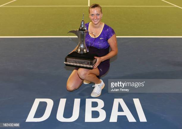 Petra Kvitova of Czech Republic poses next to the Dubai logo with the trophy after defeating Sara Errani of Italy in the final during day six of the...