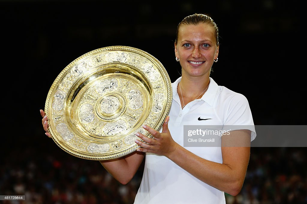 Petra Kvitova of Czech Republic poses with the Venus Rosewater Dish trophy after her victory in the Ladies' Singles final match against Eugenie Bouchard of Canada on day twelve of the Wimbledon Lawn Tennis Championships at the All England Lawn Tennis and Croquet Club on July 5, 2014 in London, England.