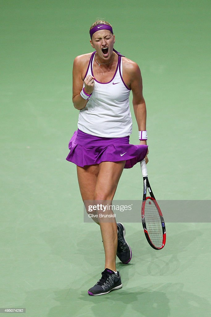Petra Kvitova of Czech Republic reacts to a point against Maria Sharapova of Russia in the semi-final match of the BNP Paribas WTA Finals at Singapore Sports Hub on October 31, 2015 in Singapore.